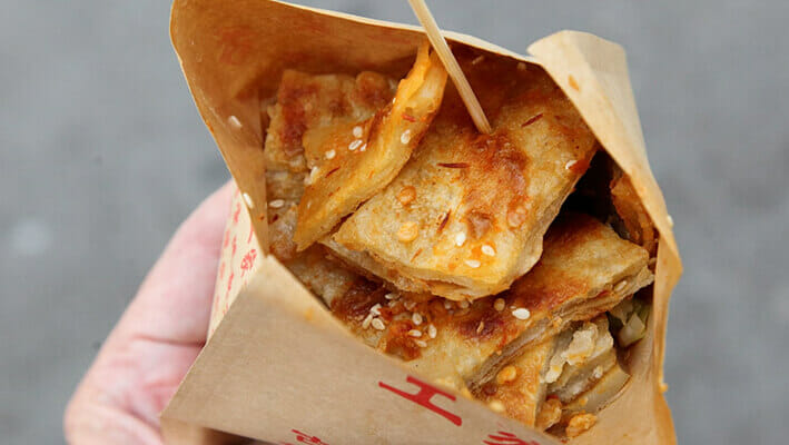 Chinese Xiang Bing Pizza street food pizza eaten with chopsticks