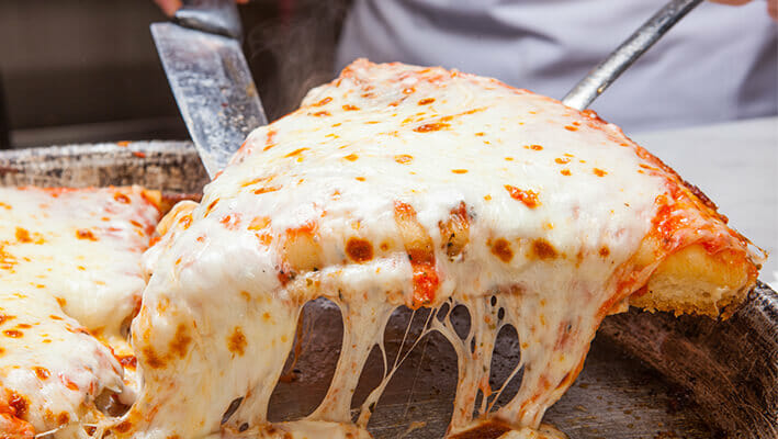 Milan-style Pizza with a lot of cheese