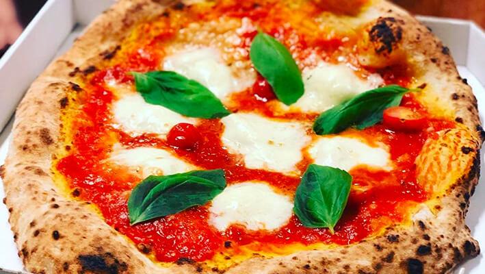 Neapolitan Pizza, classic Margherita pizza with tomato sauce, mozzarella and basil
