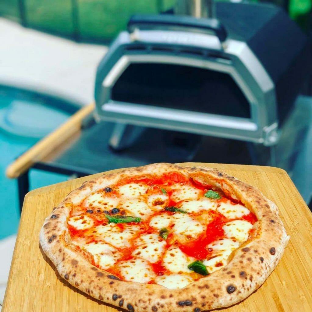Margherita Pizza in front of Ooni Karu 16