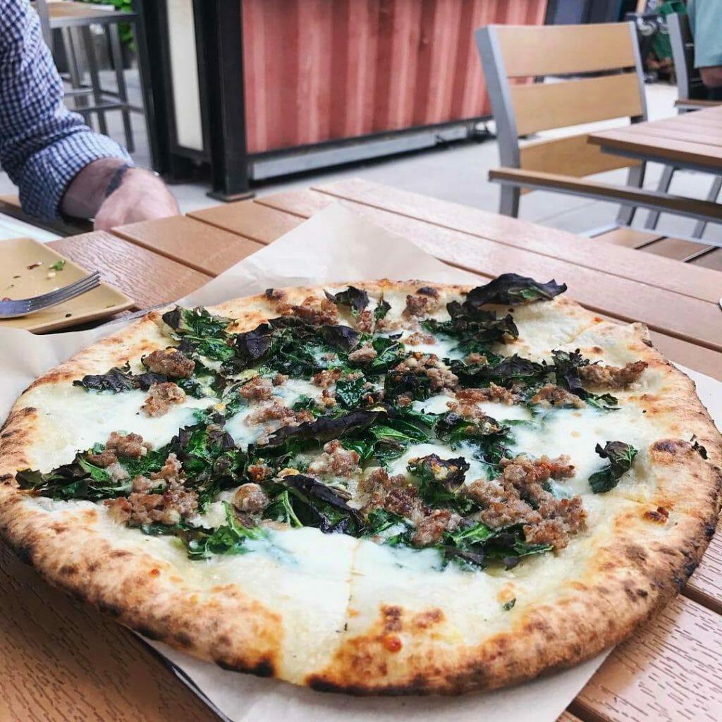 Sausage & Kale Pizza with mozzarella