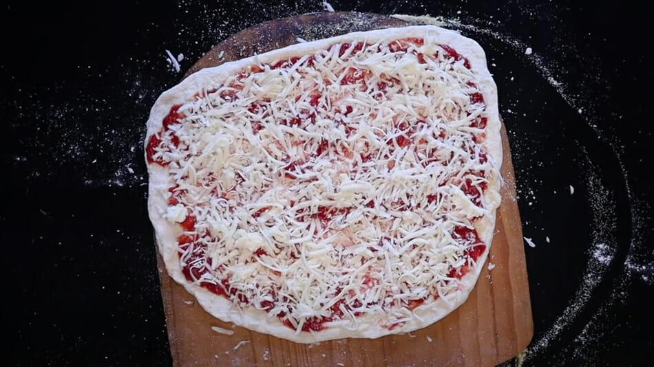 Adding mozzarella to NY-style pizza